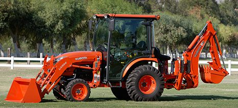 Kubota B2650 compact tractor with cab and implements. (Courtesy: Kubota)